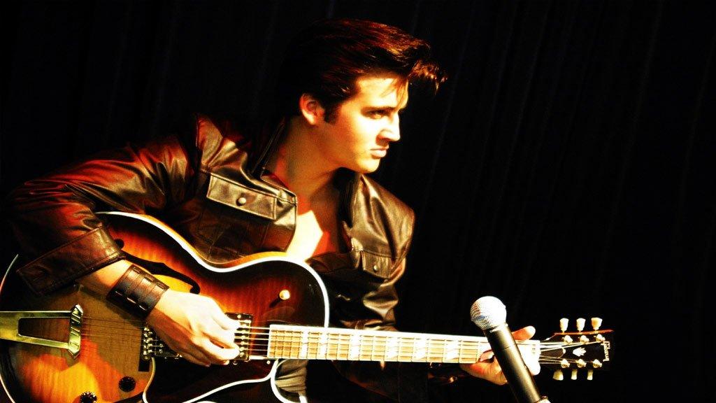Phojoe Elvis Presley Playing the Guitar